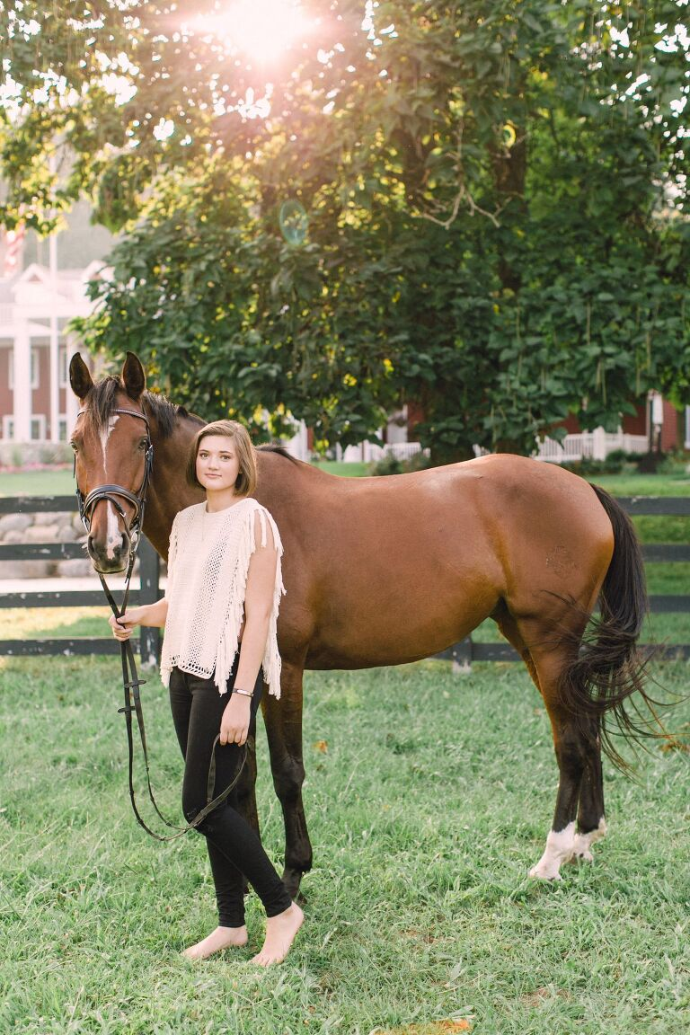 A girl with her horse for her senior portraits