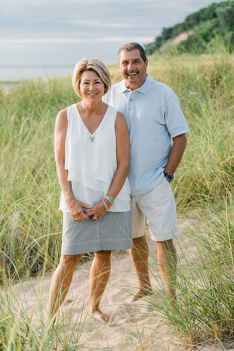 Couple smiling on a beach in Northern Michigan