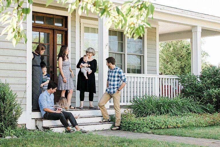 Grandma, kids, and grandkids talking on a porch