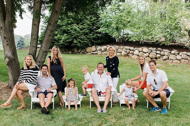 Family portrait on a lawn on the Old Mission Peninsula in Michigan