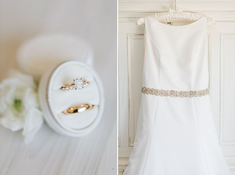 White high neck wedding dress with a sparkly belt around the waist hanging from a white armoire dresser