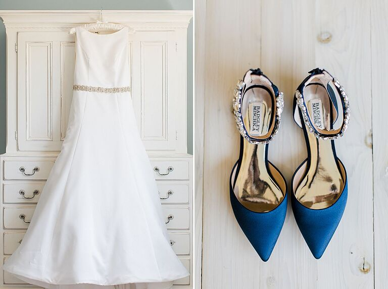 A white wedding dress embellished with a sparkly belt and pointy, navy blue, flat Badgley Mischka shoes accented with sparkly crystals at the ankle strap