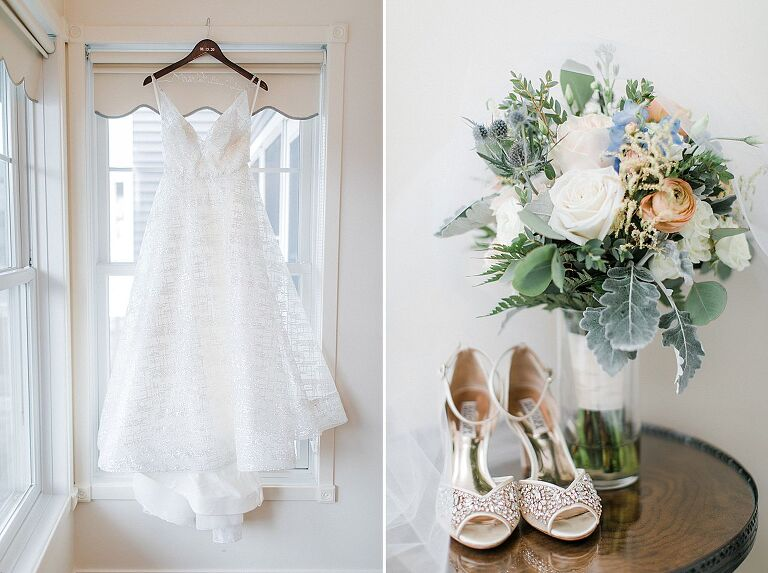 A white wedding dress hanging from a window and bridal shoes and bouquet